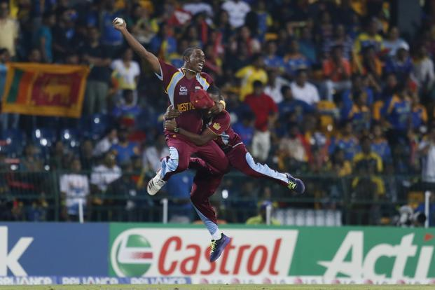 The West Indies's Dwayne Bravo celebrates as he holds a catch to dismiss the last Sri Lankan wicket during the Twenty20 World Cup final on Sunday. Photo: Gemunu Amarasinghe/AP
