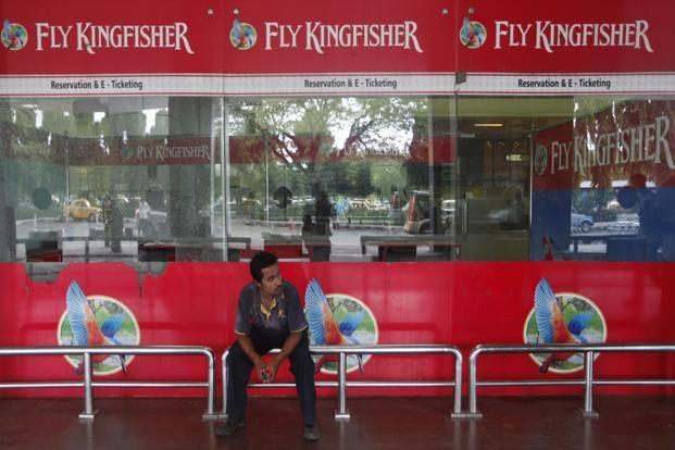 An airlines staff member sits in front of a closed Kingfisher Airlines ticketing counter at the airport in Kolkata on Wednesday. Photo: Rupak De Chowdhuri/Reuters