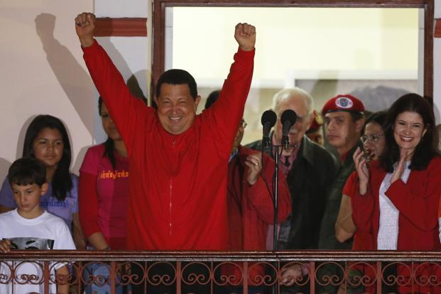 Venezuelan president Hugo Chavez celebrates from a balcony at Miraflores Palace in Caracas. Photo: Reuters
