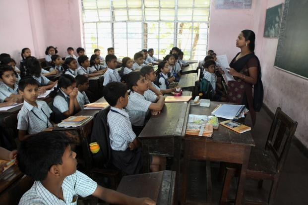 The government expects to achieve 90% gross enrolment ratio in secondary education by 2017 and reduce the student drop out rate to 25% from nearly 50%. Photo: Hindustan Times