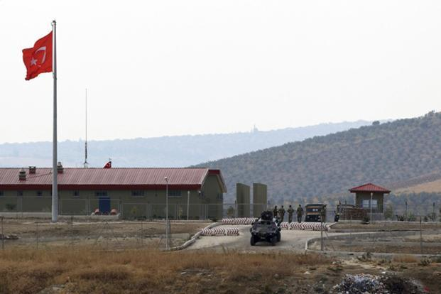 A Turkish armoured personnel carrier at a military border post on the Turkish-Syrian border near the village of Hacipasa in southern Turkey. Photo: Osman Orsal/Reuters