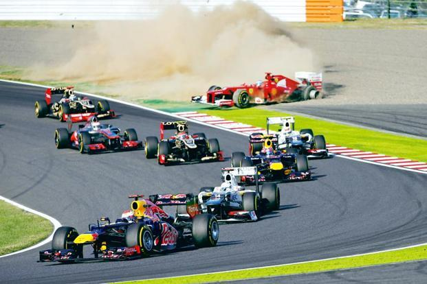 Germany's Red Bull driver Sebastian Vettel leading the field at the Japanese F1 Grand Prix at Suzuka on 7 October. Photo: Mark Baker/AP