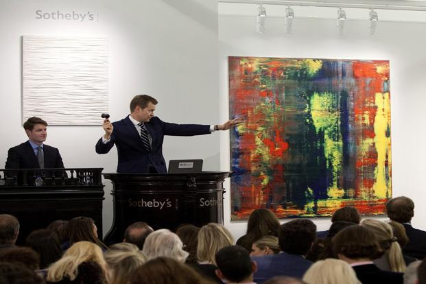 An auctioneer directs bidding for the sale of Gerhard Richter's 'Abstraktes Bild (809-4)' at Sotheby's auction house in London on Friday. Photo: Reuters/Sotheby's/Handout