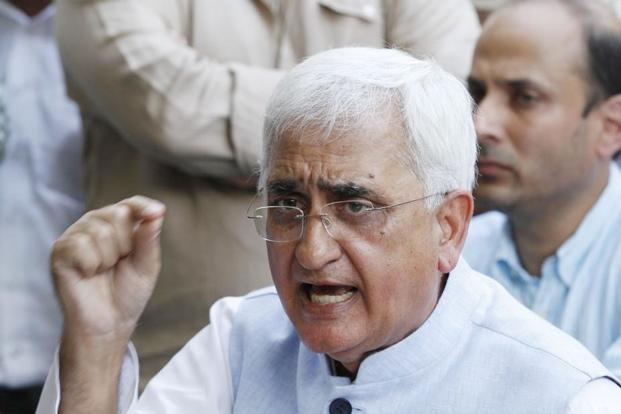 Union minister for law and justice Salman Khurshid addresses a press conference in New Delhi on Sunday. Khurshid released pictures of camps organized by his trust to defend himself against allegations by a media organization. Photo: Arvind Yadav/Hindustan Times