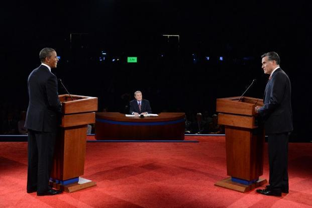 A file photo of US President Barack Obama (left) and Republican challenger Mitt Romney (right) participating in their first debate at the University of Denver in Denver, Colorado. Photo: Michael Reynolds/AFP