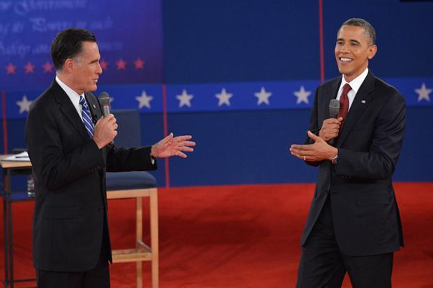US President Barack Obama , right, and Republican presidential candidate Mitt Romney speak during the second presidential debate on Wednesday at Hofstra University in Hempstead, NewYork. Photo: Carolyn Kaster/AP