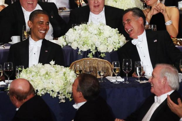 US President Barack Obama (left) and Republican presidential candidate Mitt Romney (right) share a laugh at the 67th Annual Alfred E. Smith Memorial Foundation Dinner on Thursday in New York City. Photo: Mario Tama/Getty Images/AFP