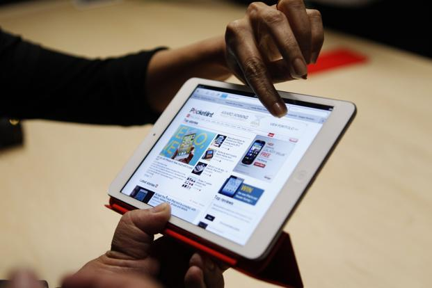 Visitors look over the new iPad mini at an Apple event in San Jose, California, on Tuesday. Photo: Robert Galbraith/Reuters