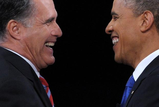 President Barack Obama (R) greets Republican presidential candidate Mitt Romney (L) following the third and final presidential debate at Lynn University in Boca Raton, Florida. Photo: Saul Loeb/AFP