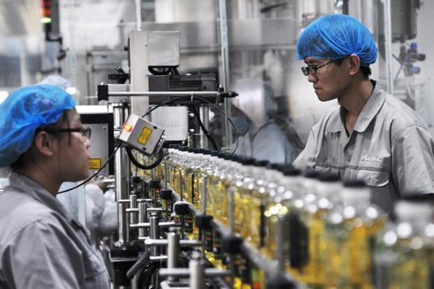 The uptick in the headline index, along with rises in new orders and output and broad improvement in export orders, inventories and prices charged, all signal a turnaround in the world's second-biggest economy. Photo: AFP (AFP)