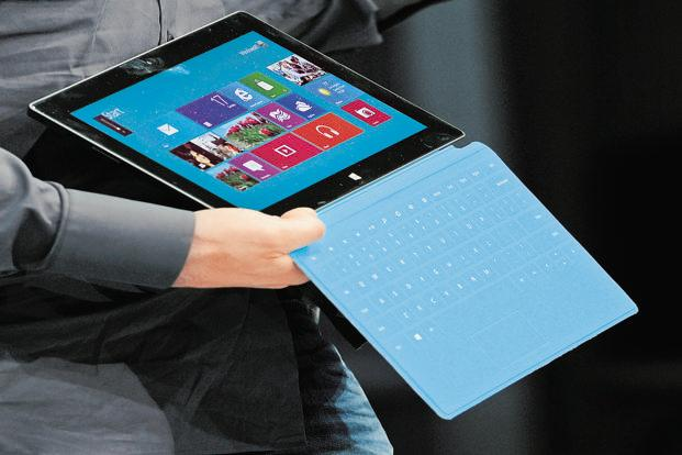 Microsoft begins selling the Surface on Friday, joining the fight in a tablet market dominated by Apple Inc's iPads and devices using Google Inc's Android system. Photo: AFP