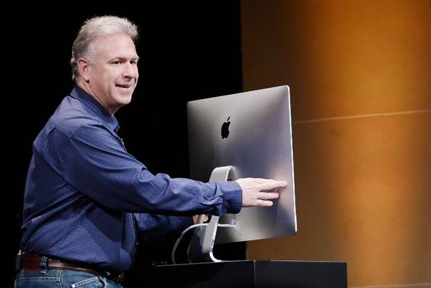 On Tuesday, Apple took the lid off a slimmed-down iMac and a 13-inch laptop with a vastly improved screen. Photo: AFP