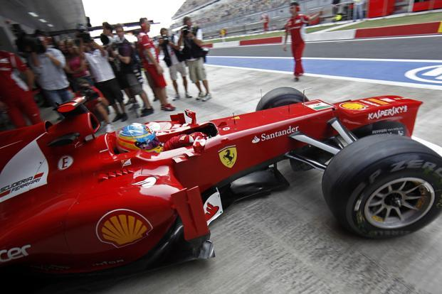An Italian Navy flag is seen on the nose cone of the car of Ferrari Formula One driver Fernando Alonso of Spain. Photo: Reuters