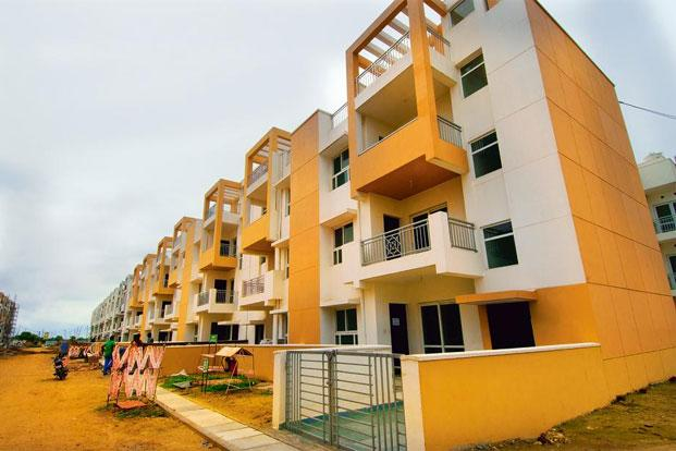 A file photo of a real estate project. Many PE funds that invested in real estate firms or projects during the sector's peak years of 2006-07 are nearing the end of their investment horizon, which means they need to return money, preferably profits, to their investors. Photo: Ramesh Pathania/Mint