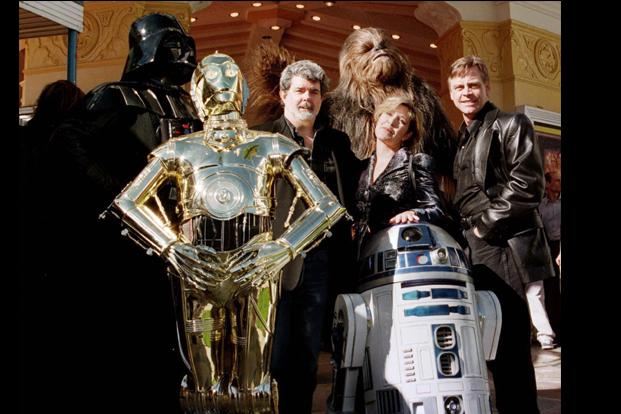 Lucas (centre) with actors Carrie Fisher and Mark Hamill and  Darth Vader, 3CPO,  R2D2 and Chewbacca at the <i>Star Wars </i>Special Editon event in Los Angeles on 18 January 1997. Reuters