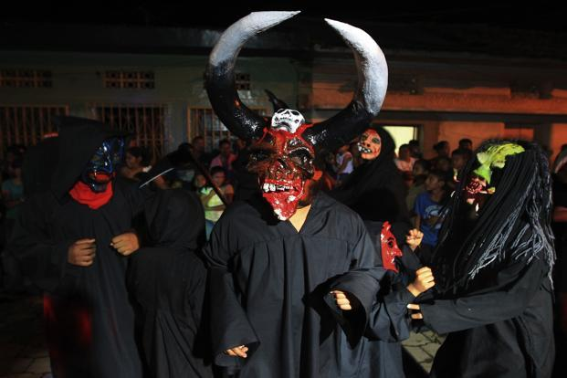 A reveller takes part in the Los Aguizotes festival in Masaya city, Managua, Nicaragua. During Los Aguizotes, residents dress up as ghosts and other spirits of the dead from Nicaraguan myths and legends. Reuters