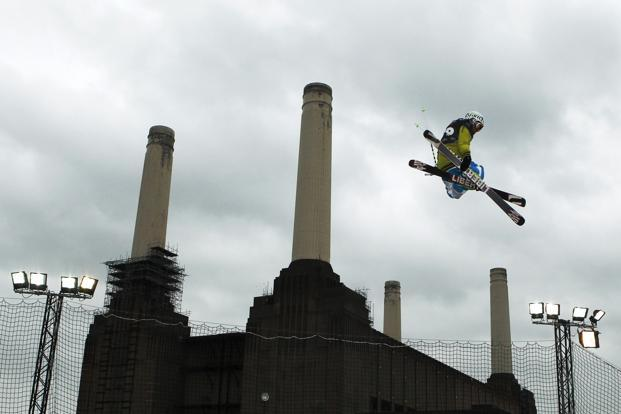 A freestyle skier soars during the Relentless Freeze Festival at Battersea Power Station in London. Reuters