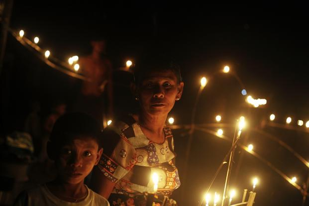 Buddhist Rakhine people displaced by violence, light candles during the Festival of Lights, also known as Thadingyut, at a monastery that is used as a refugee camp in Sittwe, Myanmar. Reuters