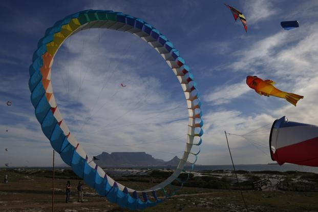 Onlookers watch as giant kites take to the skies at Blouberstrand during the annual Cape Town International Kite Festival, which takes place this weekend in South Africa. Reuters