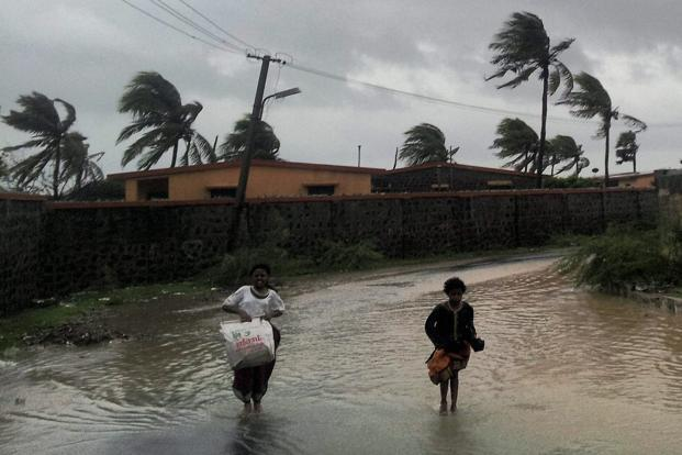 Downpours triggered by cyclone Nilam that hit the coast last Wednesday near Chennai left hundreds of villages inundated and 60,000 people in relief camps. Photo: PTI