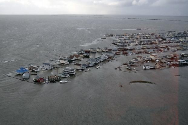 Flooded homes in Tuckerton, New Jersey, on 30 October after Hurricane Sandy made landfall on the southern New Jersey coastline on 29 October. Though there is still uncertainty over its exact course and timing, the new coastal storm could bring windy conditions with high winds in the range of 50 miles per hour. Photo: AFP