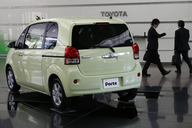 Toyota's Porte is displayed at its headquarters in Tokyo on Monday. Toyota and its group companies sold a total of 7.4 million vehicles worldwide in January-September, beating GM and Volkswagen to be the top selling carmaker. Photo: Kim Kyung-Hoon/Reuters