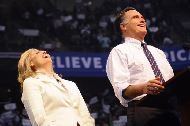 US Republican presidential candidate Mitt Romney and his wife Ann share a laugh on stage during his last campaign rally in Manchester. AFP