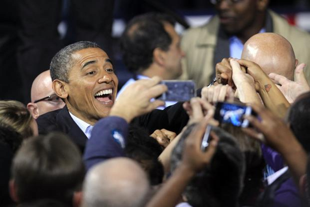 Obama greets supporters after speaking at his final campaign stop in Des Moines, Iowa. AP