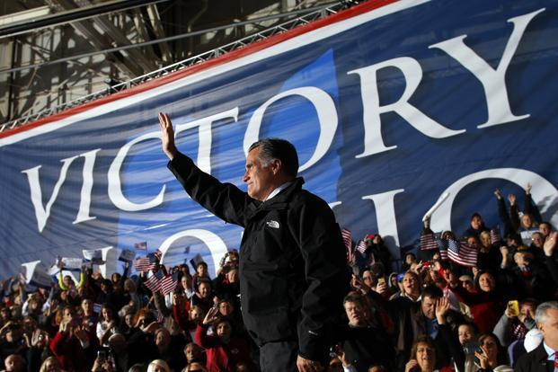Mitt Romney waves to the crowd during his campaign rally at the airport in Columbus, Ohio. Reuters