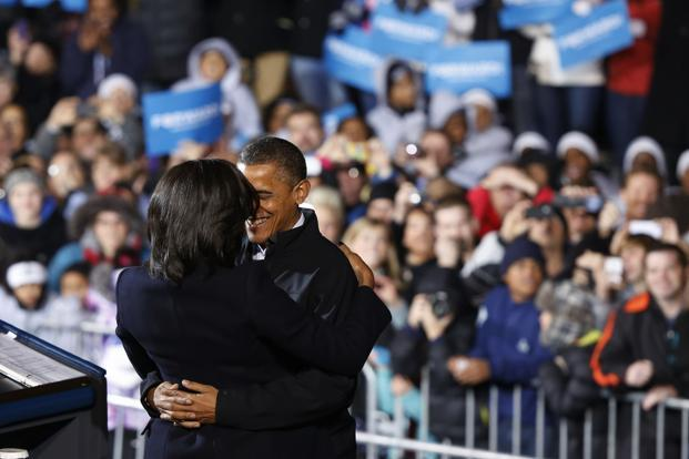 Barack Obama hugs his wife Michelle before he addresses supporters on the last night of campaigning in downtown Des Moines, Iowa. Reuters