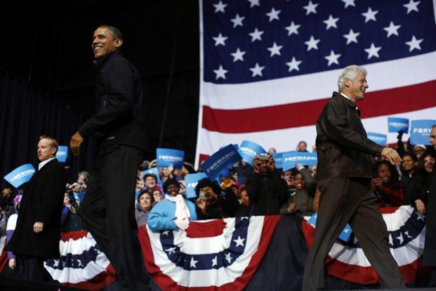 Former US President Bill Clinton introduces US President Barack Obama during a campaign rally in Bristow, Virginia on 3 November 2012. Reuters
