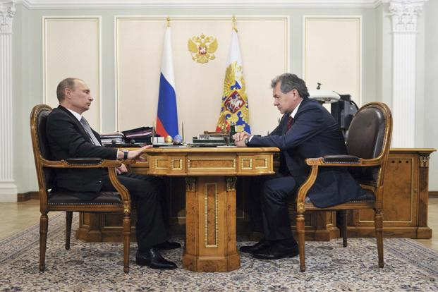 Russian President Vladimir Putin (left) meets with newly appointed defence minister Sergei Shoigu at the Novo-Ogaryovo state residence outside Moscow on Tuesday. Photo: Aleksey Nikolskyi/Reuters