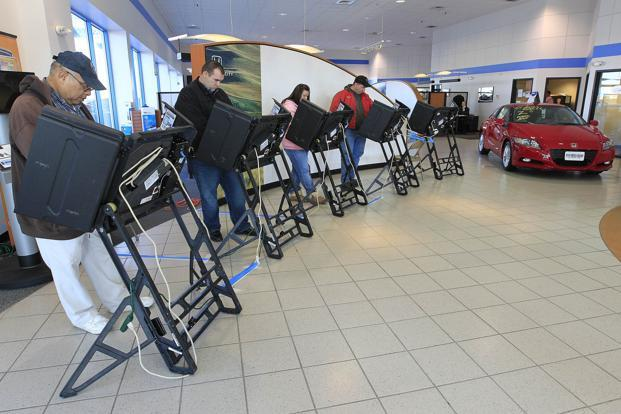Voters cast their ballots in a car dealership on Tuesday in Columbus, Ohio. Photo: Jay LaPrete/Getty Images