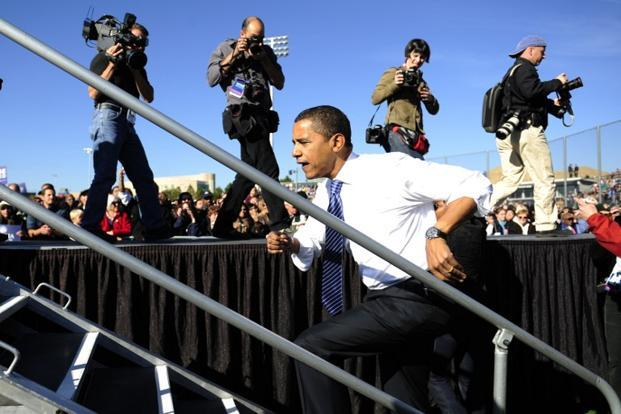 25 October 2008: US Democratic presidential candidate Illinois Senator Barack Obama gets back on stage after his microphone started working during a rally at the University of Nevada in Reno, Nevada. AFP