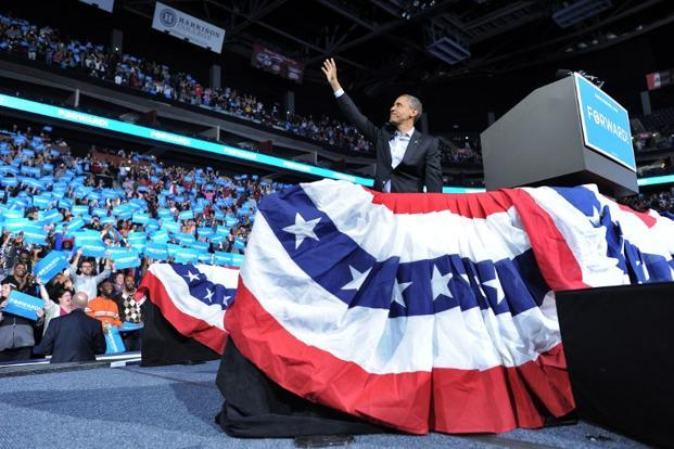5 November 2012: US President Barack Obama waves at supporters during a campaign rally in Columbus, Ohio. AFP