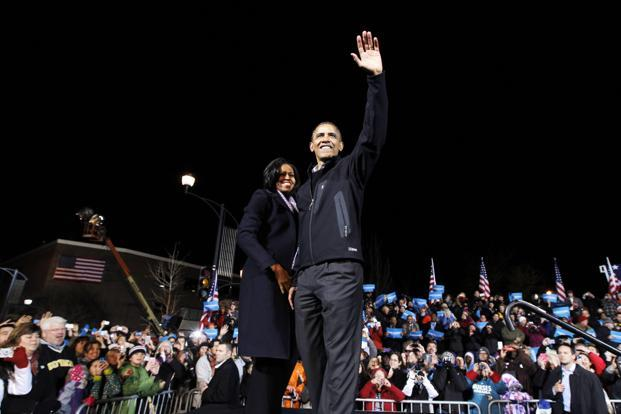 5 November 2012: US President Barack Obama waves to supporters as he stands next to first lady Michelle Obama during his final presidential campaign rally in Des Moines, Iowa. Reuters