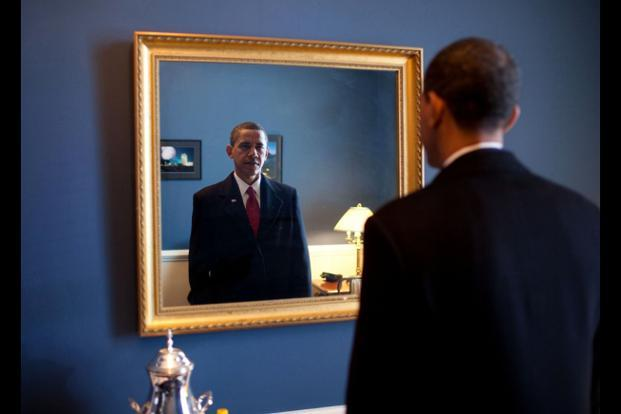 20 January 2009: President-elect Barack Obama was about to walk out to take the oath of office. Backstage at the US Capitol, he took one last look at his appearance in the mirror. Official White House Photo.