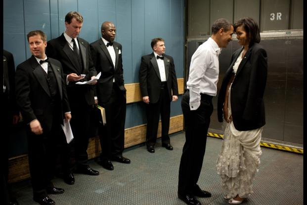 20 January 2009: During a freight elevator headed to one of the Inaugural Balls, the President removed his jacket and put it over the shoulders of his wife and staff members tried not to look! Official White House Photo.