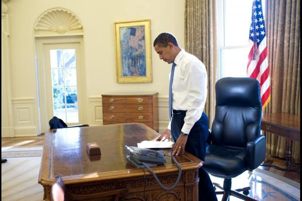 21 January 2009: Obama's first morning in the Oval Office as President of the US. Official White House Photo.