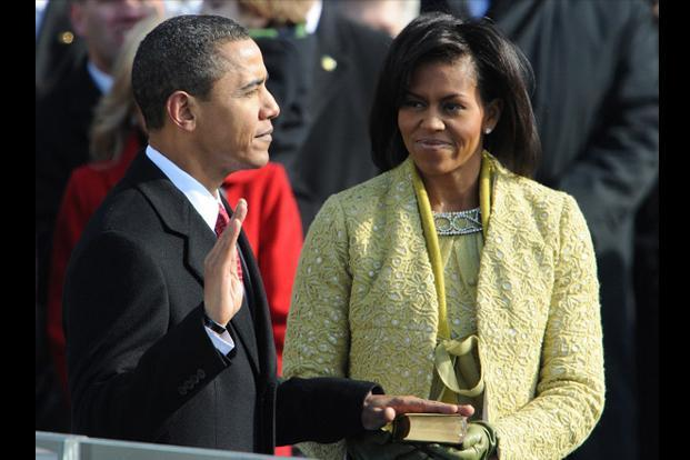 20 January 2009: Barack Obama (L) is sworn in as the 44th US president as his wife Michelle holds the Lincoln Bible at the US Capitol in Washington, DC. AFP