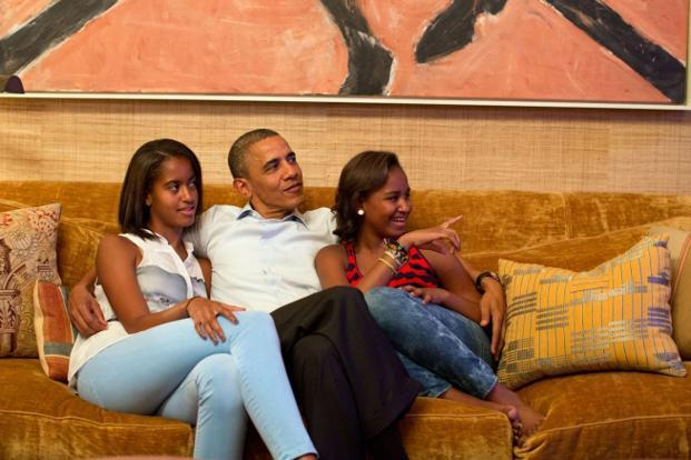 4 September 2012: Obama and his daughters, Malia, left, and Sasha, watch TV as first lady Michelle delivers her speech at the Democratic National Convention in the White House. Official White House Photo by Pete Souza.
