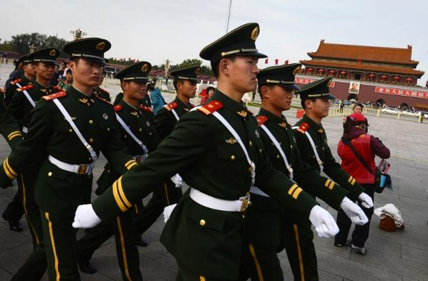 Paramilitary police march through Tiananmen Square on the eve of the Chinese Communist Party's congress to elect a new leader in Beijing. Photo: AFP