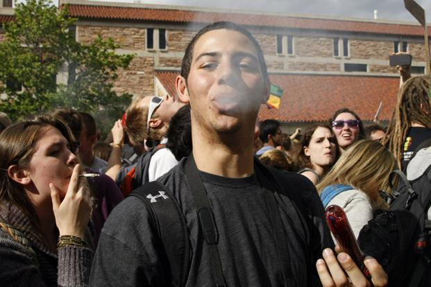 A man exhales after smoking marijuana in a pipe at a pro-marijuana rally at the University of Colorado in Boulder, Colorado. Photo: Reuters