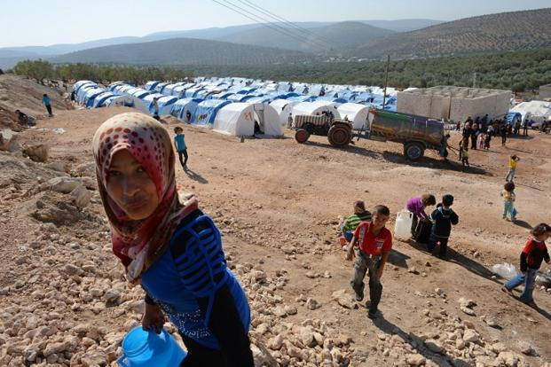 Most of the surge in refugees was due to the 9,000 fleeing into Turkey, including more than 70 who were wounded, UN officials said. Photo: AFP