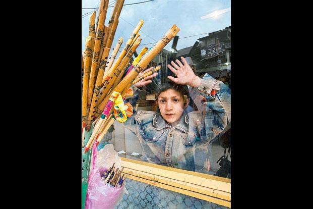 A boy photographed on Residency Road, Srinagar, in 2008. Photographs: Amit Mehra.