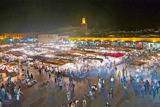 Visitors stream into Marrakech's Djemaa el Fna, a market on steroids. Photo: Joseph Molinari