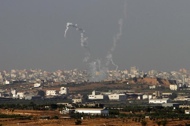 Trails of smoke seen after the launch of rockets from the northern Gaza strip towards Israel on Sunday. Amir Cohen/Reuters