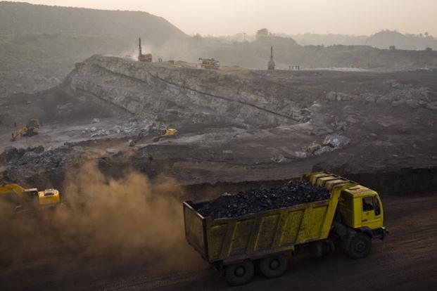 A truck carrying coal drives out of an open-cast coal mine in Jharkhand. One good quarter followed by a weak quarter sums up the trend in Coal India's performance for the past six quarters. Photo: Getty Images