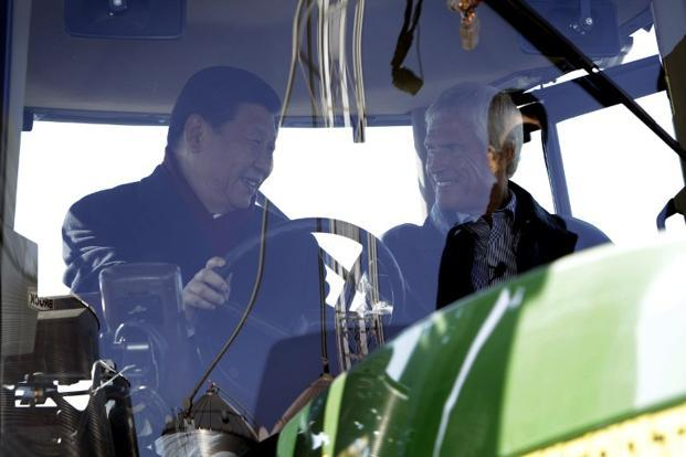 Xi talks to a farmer Rick Kimberley as they sit in the cab of a tractor while touring the latter's family farm on 16 February 2012 in Maxwell, Iowa. AFP