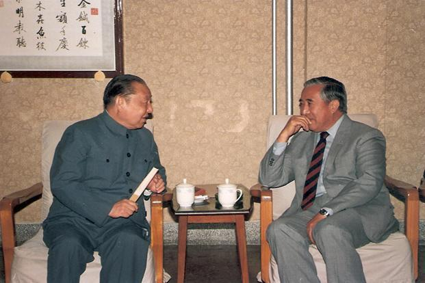 Xi Zhongxun (left), China's former premier and father of China's Vice President Xi Jinping, talks with Gyalo Thondup, brother of the Dalai Lama, in Beijing in 1987. Reuters